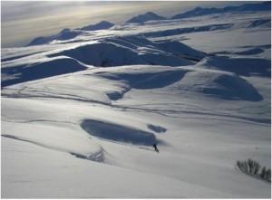 Snowboarding off of a cornice near Fielding Lake south of Fairbanks.